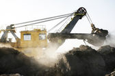 Yellow mine excavator at work — Stock Photo