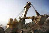 Mine excavator at work — Stock Photo