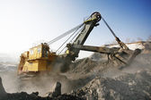 Yellow mine excavator at worksite — Stock Photo