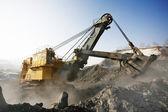 Yellow mine excavator at worksite — Stock Photo