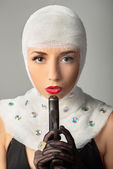 Woman with bandages and gun — Stock Photo