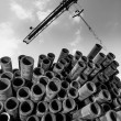 Crane and stack of pipes — Stock Photo