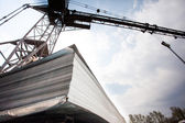 Crane and stack of steel plates — Stock Photo