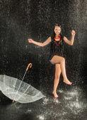 Happy girl with rain and transparent umbrella — Stock Photo