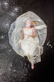 Bride sitting under rain — Stock Photo