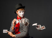Clown throws playing cards — Stock Photo