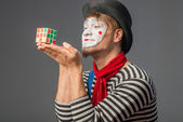 Grimacing clown with Rubik's Cube — Stock Photo