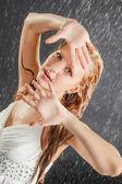 Blonde girl in dress in water studio — Stock Photo