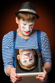 Clown grimacing before a mirror — Stock Photo