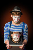 Clown grimacing before a mirror — Foto Stock