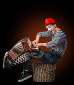 Clown playing on accordion — Stock Photo