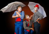 Clowns with umbrellas — Stock Photo