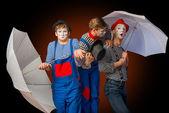 Clowns with umbrellas — Stock Photo