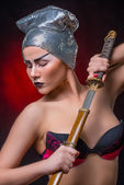 Woman with samurai sword — Stock Photo