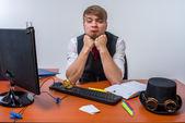 Businessman sitting at desk — Stock Photo