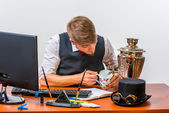 Businessman sitting at desk — Stock Photo