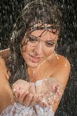 Bride posing under the rain — Stock Photo