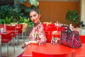 Brunette woman resting in cafe — Foto Stock