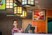 Brunette woman in cafe — ストック写真