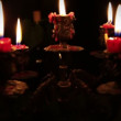 Stock Video: Candles in candelabrum with five branches in full dark