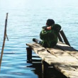 Video Stock: Alone boy throw rocks in the lake water