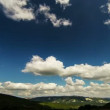 Wide Angle view to green mountains with timelapse clouds — Stock Video #34632329