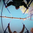 Mother with little son together on the swing - unusual fisheye view — Vídeo de stock