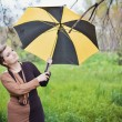 Girl with umbrella at autumn park — Stock Photo