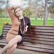 Young girl sitting on bench — Stockfoto #29349283