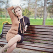 Young girl sitting on bench — Foto Stock #29349283