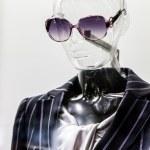 Female translucent mannequin in suit with sunglasses — Stock Photo