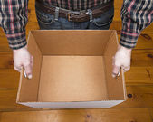 Empty Box and Flannel — Stock Photo