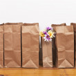 Stock Photo: Brown Bags and Flowers