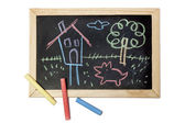 Child drawing on a blackboard — Stock Photo
