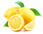 Lemon with green leaves — Stock Photo