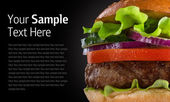 Hamburger on black background — Stock Photo