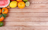Fruits on wood texture background — Stock Photo