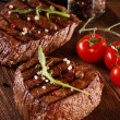 Close up of two juicy thick portions of delicious roasted or grilled beef steak — Stock Photo #46392163