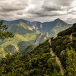 Cloudy road in mountains — Stock Photo