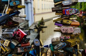 Love locks locked on a fence — Stock Photo