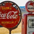 Retro gas pump and rusty coca-cola sign on route 66 — Stock Photo #30379625
