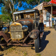 Rusty oldtimer on Route 66 in the Mojave desert — Stock Photo #30438219
