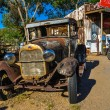 Rusty oldtimer on Route 66 in the Mojave desert — Stock Photo