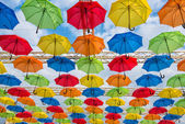 Many umbrellas coloring the sky — Stock Photo