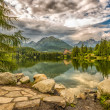 Glacial mountain lake Strbske Pleso in National Park High Tatra, — Stock Photo #50113957