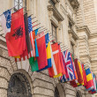 International set of flags at the Hofburg palace in Vienna — Stock Photo #50693625