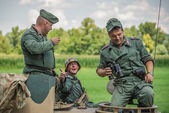 German soldier talking to comrades on a tank — Stock Photo