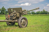Cannon from World War II  on a battlefield — Stock Photo