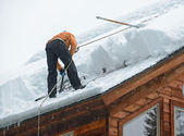 Clearing Ice Dams — Stock Photo