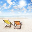 Beach chairs on the white sand beach with beautiful cloudy blue sky — Stock Photo #30158517